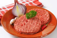 Two raw hamburger patties Royalty Free Stock Photos