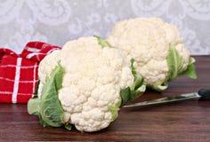 Two raw heads of fresh cauliflower. Stock Image