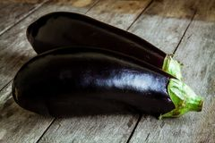 Two raw organic eggplant on old wooden background Stock Images