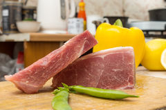 Two raw piece of meat on a wooden cutting board Royalty Free Stock Images