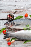 Two raw seabass with spices Stock Photo