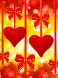 Two read hearts and bows royalty free stock images