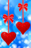 Two read hearts hanging stock photo