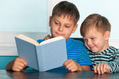 Two reading boys at the desk Royalty Free Stock Images