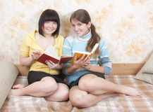 Two reading friends Stock Image