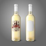 Two realistic bottles for white wine with labels Stock Image