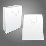 Two realistic white blank paper bags. Isolated on Stock Photos