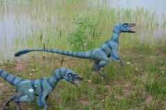 The two of reconstructions of Mesozoic reptiles. July 9, 2017, JuraPark in Krasiejow, Poland. Mesozoic reptiles close to the original and of natural size in the Stock Image