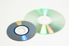Two recordable discs. Mini disc and compact disc on white Royalty Free Stock Photography