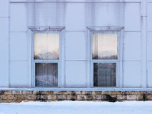 Two rectangular windows with siding imitating steel, on large sports complex.  Royalty Free Stock Images