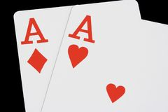 Two Red Aces on Black. Ace of hearts and Ace of diamonds on black background Royalty Free Stock Photo