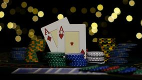 Two red aces, chance to win. Poker. Close up. Combination of poker. Pair of aces, good card combination, one pair of aces, poker game on gamblimg table, green stock video footage