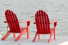 Two Red Adirondack Chairs Royalty Free Stock Photos