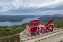 Free Two Red Adirondack Chairs With A Grand Vista 2 Royalty Free Stock Images - 159388589
