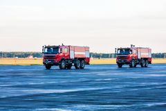 Two red airfield fire trucks at the airport. Apron Royalty Free Stock Photography