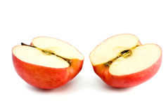 Two red apple halves. Isolated on the white background Royalty Free Stock Photography