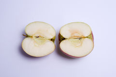 Two red apple halves isolated on the white background Royalty Free Stock Images