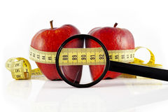 Two red apple meter and magnifying glass Royalty Free Stock Image