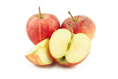 Two red apples, half and a slice Stock Photos