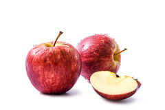 Two red apples and a quarter of apple isolated on white background Stock Photo