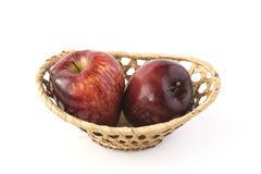 Two red apples in a wicker basket Royalty Free Stock Images