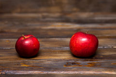 Two red apples on a wooden background. Two red, ripe apples on a wooden background close up Stock Photo