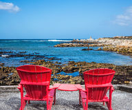Two red armchairs chaise longue. By Atlantic ocean. Boulders Penguin Colony in the Table Mountain National Park, South Africa. The concept of ecotourism stock photos