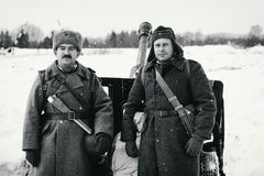 Two Red Army cannoneers near the 76-mm divisional gun M1942 ZiS-3.  Black and white photo. Royalty Free Stock Image