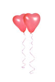 Two red balloons in the shape of a heart Stock Photo