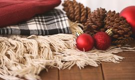 Two Red Baubles Beside Pine Cones Stock Photography