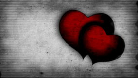 Two red beating hearts on a old-movie effect background stock footage