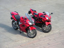 Two red beautiful motorcycles . Royalty Free Stock Image