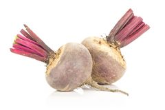 Fresh raw Beetroot isolated isolated on white. Two red beet young bulbs isolated on white background cut tops Stock Photo