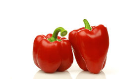 Two red bell peppers. On a white background Stock Image
