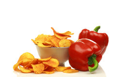 Two red bell peppers and paprika chips Stock Photography
