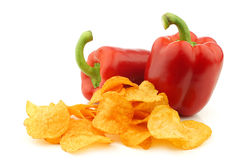 two red bell peppers and paprika chips Royalty Free Stock Photos