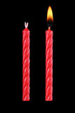 two red birthday candles isolated on black Stock Photos