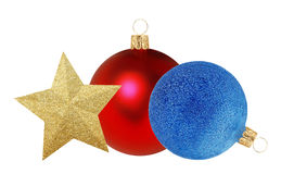 Two red and blue Christmas decor balls and gold star isolated on Stock Photos
