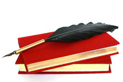Two red books and quill isolated on white Royalty Free Stock Photo