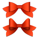 Two red bows with red ribbons. View from top Royalty Free Stock Image