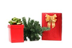 Two red boxes with bows and christmas tree. Stock Photos