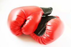 Two red boxing gloves Royalty Free Stock Images