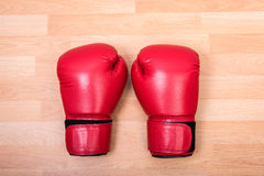 Two red boxing gloves Stock Images