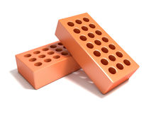 Two red bricks with round holes Royalty Free Stock Images