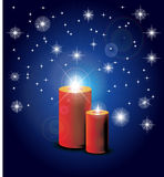 Red candles. Two red burning candles on blue background Stock Photos