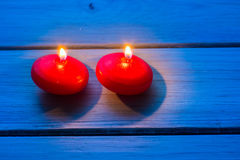 Two red burning candles Stock Photos