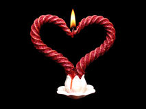 Two red burning candles spiral Stock Photos