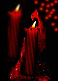 Two red burning candles. Valentine's Day card, Stock Photography