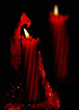Two red burning Christmas candles Royalty Free Stock Photos