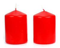Two red candle wax on a white background Royalty Free Stock Images